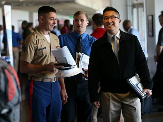 Job seekers attend the Hiring Our Heroes Job Fair at AT&T Park on August 25, 2015 in San Francisco, California. Hundreds of veterans attended the Hiring Our Heroes Job Fair that was hosted by the U.S. Chamber Foundation and the San Francisco Giants. More than 115 employers were on hand …