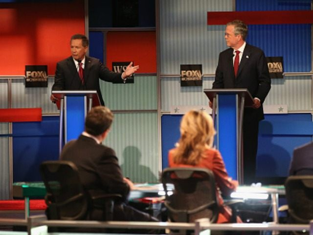 Presidential candidates Ohio Governor John Kasich (L-R) speaks while Jeb Bush and Sen. Marco Rubio (R-FL) look on during the Republican Presidential Debate sponsored by Fox Business and the Wall Street Journal at the Milwaukee Theatre November 10, 2015 in Milwaukee, Wisconsin. The fourth Republican debate is held in two …