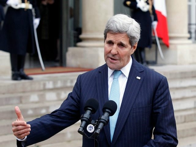 US Secretary of State John Kerry talks to the media after a meeting with French President Francois Hollande at the Elysee Presidential Palace on November 17, 2015 in Paris, France. John Kerry arrives in Paris to pay tribute to victims of last week's terrorist attacks. (Photo by