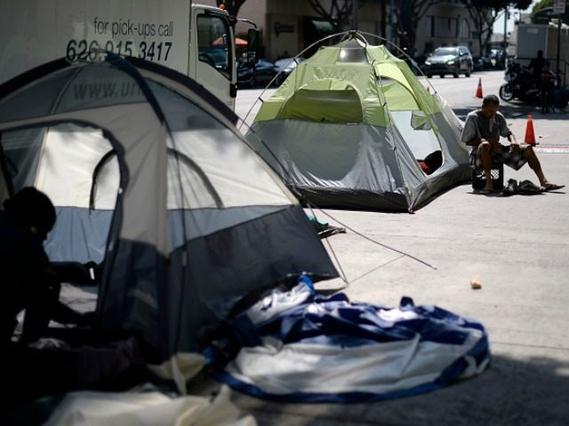 Homeless camp out September 23, 2015, in the skid row section of Los Angeles, California. Mayor Eric Garcetti and City Council members declared public emergency, the first city in the nation to take drastic step in response to increase in homelessness and that they're ready to spend $100 million per …