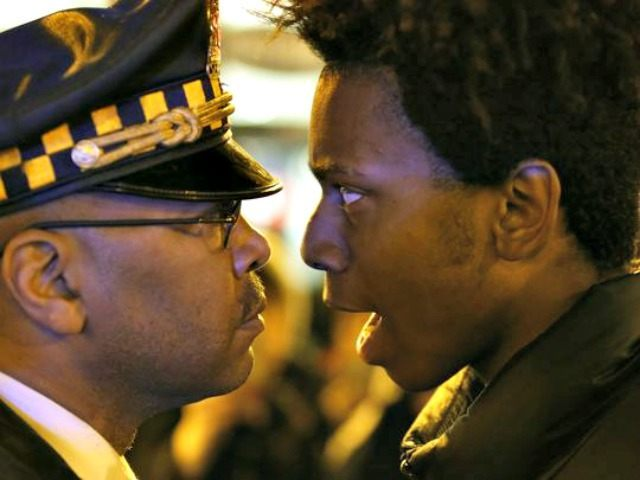 Lamon Reccord, right, stares and yells at a Chicago police officer Charles Rex Arbogast, AP