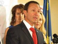Republican candidate for attorney general, Jeff Landry, speaks about the state GOP's endorsement of his campaign on Tuesday, July 28, 2015, in Baton Rouge, La. The Republican Party of Louisiana backed Landry in the Oct. 24 election over incumbent GOP Attorney General Buddy Caldwell.