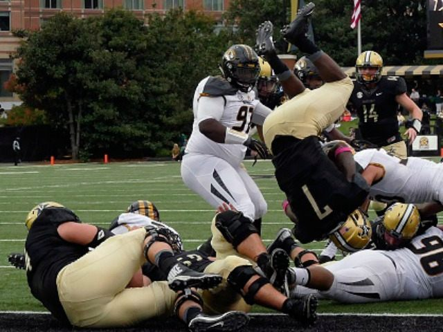 Ralph Webb #7 of the Vanderbilt Commodores dives over the pile for a touchdown against the Missouri Tigers during the first half at Vanderbilt Stadium on October 24, 2015 in Nashville, Tennessee. (Photo by