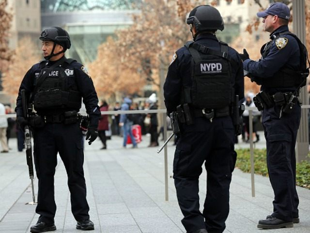 New York City police officers stand guard near One World Trade Center in lower Manhattan on November 24, 2015 in New York City. Following the terrorist attacks in Paris, security in New York City has been heightened throughout the metropolitan area as experts try to determine the nature of threats …
