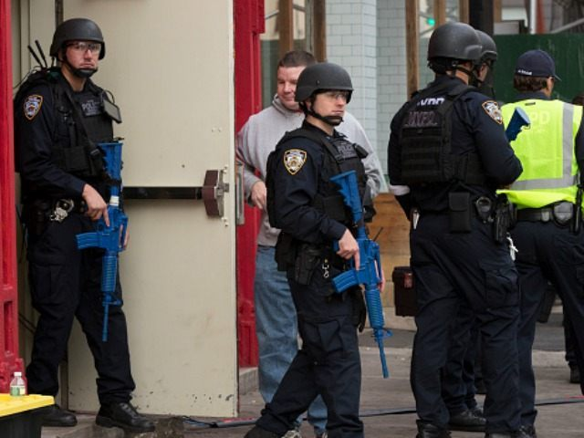 New York City Police officers during an active shooter drill on Kenmare St. on November 22, 2015 in New York City. The drill, in cooperation with the Department of Homeland Security, simulated an active shooter situation at the Bowery subway station. (