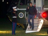 President Barack Obama salutes as he walks off Marine One after landing on the South Lawn of the White House on November 23, 2015 in Washington, DC. Obama, during a news conference in Kuala Lumpur on Sunday after more than a week of conferences and summits in Asia, said Russia must make a strategic decision about Syria and the next several weeks will show whether Russian President Vladimir Putin will give up backing the Syrian regime.