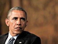 Obama Brown Background Aude Guerrucci AP