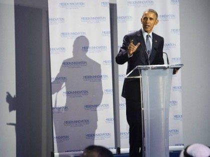 Microsoft co-founder Bill Gates (L) listens to a speech by US President Barack Obama (R) during the Mission Innovation event at the UN conference on climate change COP21 on November 30, 2015 at Le Bourget, on the outskirts of the French capital Paris. More than 150 world leaders are meeting under heightened security, for the 21st Session of the Conference of the Parties to the United Nations Framework Convention on Climate Change (COP21/CMP11), also known as ìParis 2015î from November 30 to December 11. AFP PHOTO / JIM WATSON / AFP / JIM WATSON (Photo credit should read