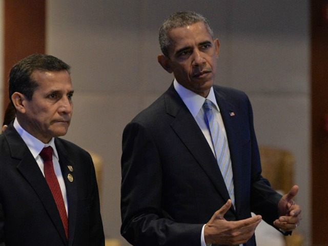 Barack Obama (R) chats with Peru's President Ollanta Humala as they arrive to take part in the leaders' 'Retreat 1' at the annual 21-member Asia-Pacific Economic Cooperation (APEC) summit in Manila on November 19, 2015. Asia-Pacific leaders are wrapping up two-days of talks in Manila that have been overshadowed by …