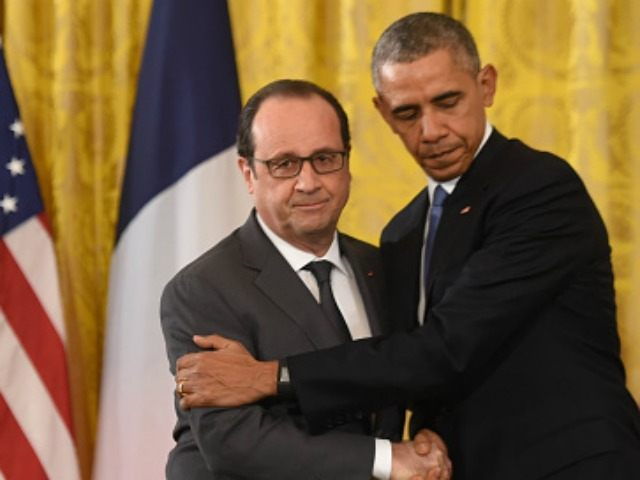 Barack Obama(R) and his French counterpart Francois Hollande hold a press conference at the White House in Washington, DC, on November 24, 2015. AFP PHOTO/NICHOLAS KAMM / AFP / NICHOLAS KAMM (Photo credit should read