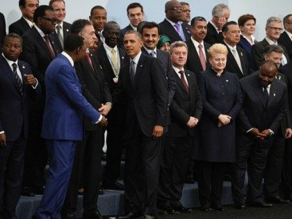 Barack Obama (5thL) is greeted by world leaders as he arrives for the family photo at the COP21, United Nations Climate Change Conference, in Le Bourget, outside Paris, on November 30, 2015. More than 150 world leaders are meeting under heightened security, for the 21st Session of the Conference of …