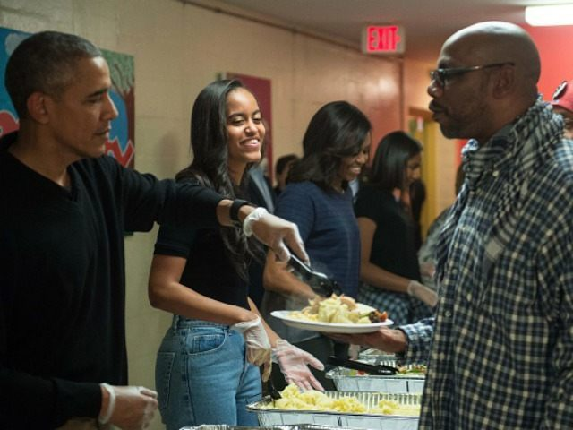 Malia Obama (2nd L), daughter of US President Barack Obama (L), smiles as they serve Thanksgiving dinner to homeless military veterans with First Lady Michelle Obama (3rd L) and daughter Sasha at Friendship Place in Washington, DC, on November 25, 2015. President Barack Obama sought to reassure jittery Americans traveling …