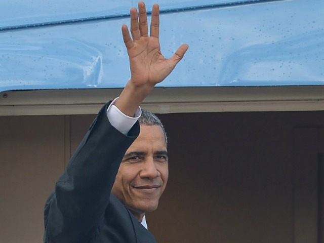Barack Obama waves as he boards Air Force One for his departure at the Royal Malaysian Airforce base in Subang, outside Kuala Lumpur on November 22, 2015, after attending the 27th Association of South East Asian Nations (ASEAN) Summit.