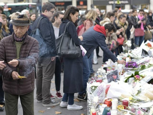 People light candles at a memorial for the victims of the attacks claimed by Islamic State which killed at least 129 people and left more than 350 injured, on November 17, 2015 at the Place de la Republique in Paris. AFP PHOTO / ADRIEN MORLENT