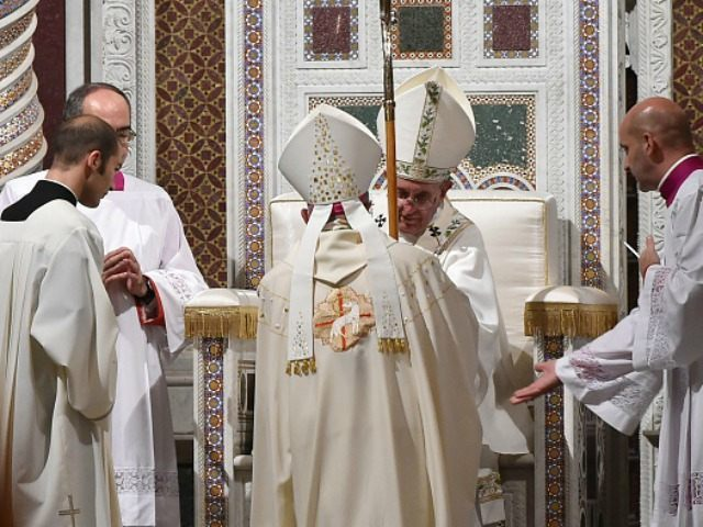 Pope Francis (C) ordinates Mons. Angelo De Donatis (back) to auxiliary Bishop of Rome, on November 9, 2015 at St John Lateran basilica in Rome. AFP PHOTO / ALBERTO PIZZOLI (Photo credit should read