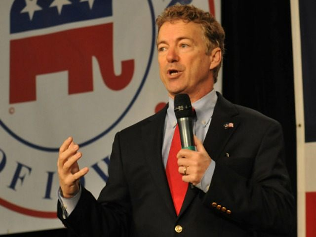 : Republican presidential candidate Sen. Rand Paul (R-KY) (L) speaks at the Growth and Opportunity Party, at the Iowa State Fair in Des Moines, Iowa, Saturday October 31, 2015. With just 93 days before the Iowa caucuses Republican hopefuls are trying to shore up support amongst the party. (Photo by
