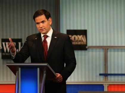 Presidential candidate Republican Sen. Marco Rubio (R-FL) speaks while Donald Trump looks on during the Republican Presidential Debate sponsored by Fox Business and the Wall Street Journal at the Milwaukee Theatre November 10, 2015 in Milwaukee, Wisconsin. The fourth Republican debate is held in two parts, one main debate for …