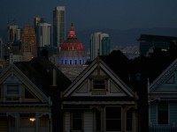 San Francisco City Hall and Paris (Justin Sullivan / Getty)
