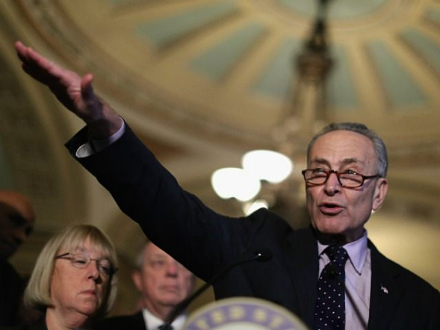 Sen. Charles Schumer (D-NY) talks to reporters following the weekly Senate Democratic policy luncheon at the U.S. Capitol November 17, 2015 in Washington, DC. Senate Democratic leaders said they will wait until after being briefed by the White House later this week before deciding how to proceed with allowing more …