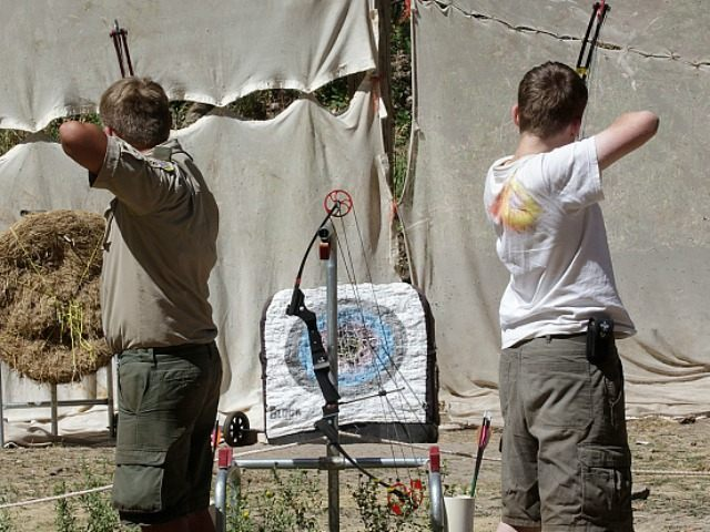 Boy Scout shoot bow and arrows at camp Maple Dell on July 31, 2015 outside Payson, Utah.