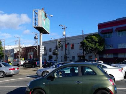 Naked man on I-80 freeway sign (Roy Munin / Twitter)