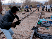 WATCH: Migrants Attack Police As Macedonia Puts Up Fence Along Greek Border