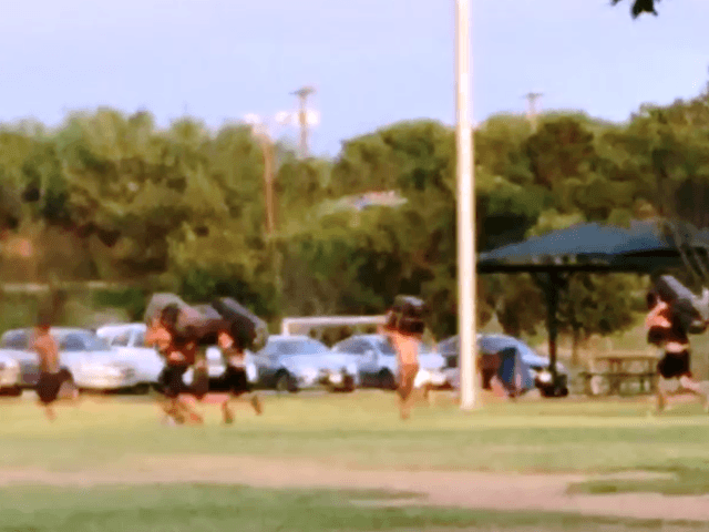 Photo of smugglers running across the park's fields with marijuana bundles on their backs. (Photo taken by an annynomous middle school student who was so upset with the actions, the student took the parent's phone and shot the pictures.)