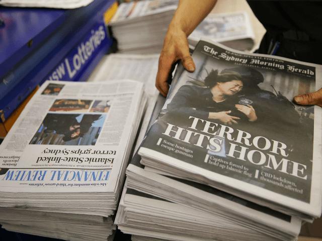 SYDNEY, AUSTRALIA - DECEMBER 16: A newsagent organises the morning papers on December 16, 2014 in Sydney, Australia.