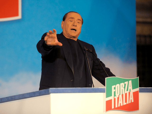 ROME, ITALY - NOVEMBER 27: Former Italian Prime Minister Silvio Berlusconi gestures as he attends a rally outside his house, Palazzo Grazioli, on November 27, 2013 in Rome, Italy.