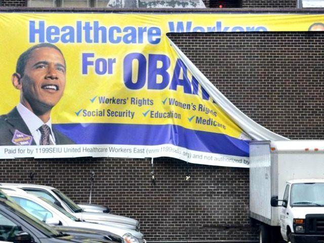 Torn Healthcare, Obama Sign AP