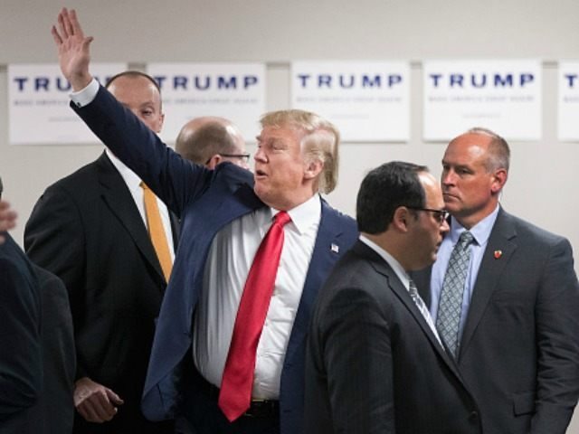 Republican presidential candidate Donald Trump waves to guests as he leaves a rally at Des Moines Area Community College Newton Campus on November 19, 2015 in Newton, Iowa. Trump is currently leading the race for the Republican presidential nomination in Iowa. (Photo by )