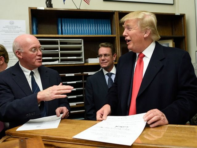 Republican presidential candidate Donald Trump files for the New Hampshire state ballot as New Hampshire Secretary of State William Gardner (L) looks on, November 4, 2015 in Concord, New Hampshire. AFP PHOTO/DON EMMERT (Photo credit should read