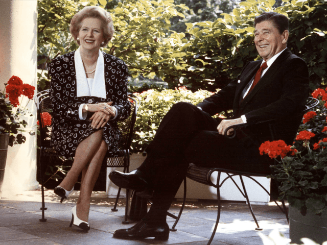 This 17 July, 1987 file photo shows former US President Ronald Reagan and former British Prime Minister Margaret Thatcher as they pose for photographers on the patio outside the Oval Office, Washington,DC.