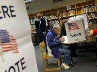 Steve Maskell of McLean, Va., right, votes on election day in McLean, Va., Tuesday, Nov. 5, 2013. ()