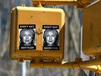 Anti-Hillary Clinton posters are seen on a sign post in Brooklyn on April 16, 2015, just blocks from Clintons new Brooklyn , New York 2016 presidential campaign headquarters . The posters feature illustrations of Clintons face along with slogans, including: Dont Say Secretive and Dont Say Entitled. AFP PHOTO / TIMOTHY A. CLARY (Photo credit should read