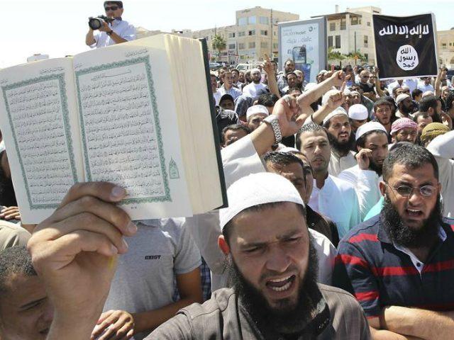 http://media.breitbart.com/media/2015/11/koran-and-black-islamic-flag-isis-file-photo-Reuters.jpg