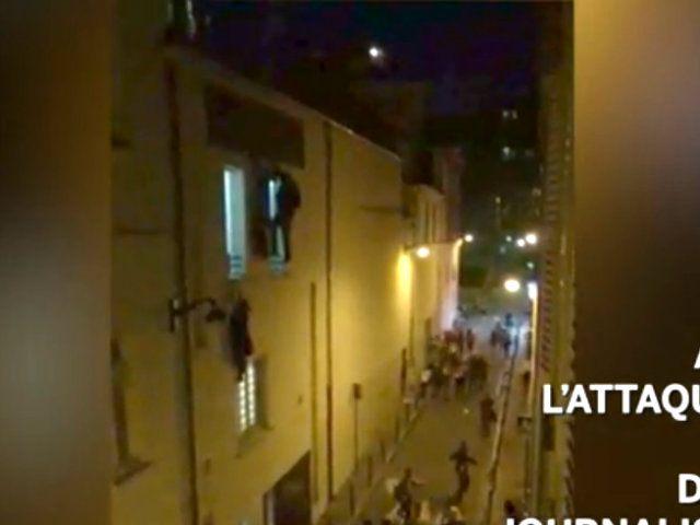 People flee in the street below