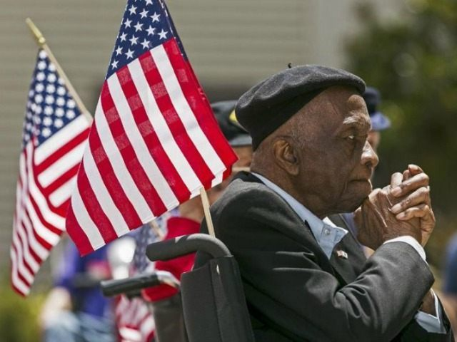 United States Army veteran Sgt. Leon Brookings, celebrates the U.S. Army's 238th Birthday Celebration, Flag Day at the third anniversary of the West Los Angeles Veterans Home, Friday, June 14, 2013, in Los Angeles.