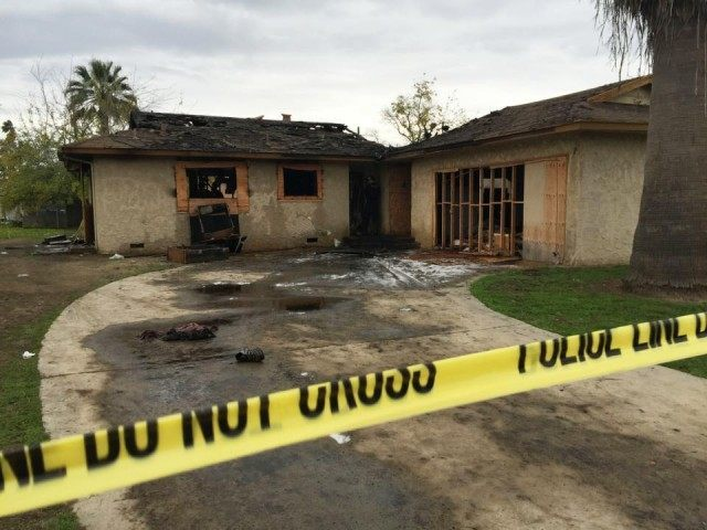 Fatal House Fire in Fresno (Paul Schlesinger/The Fresno Bee via AP)