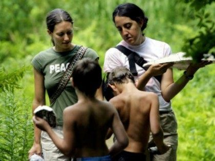 Program Co-Director Lannie Moore (L) and Instructor Laura Kaplan (R) walk with students after making plaster casts of animal tracks at the Center for Attention and Related Disorders? (C.A.R.D.) camp at the Great Hollow Wilderness School July 29, 2003 in New Fairfield, Connecticut. The four-week camp boasts one instructor for …