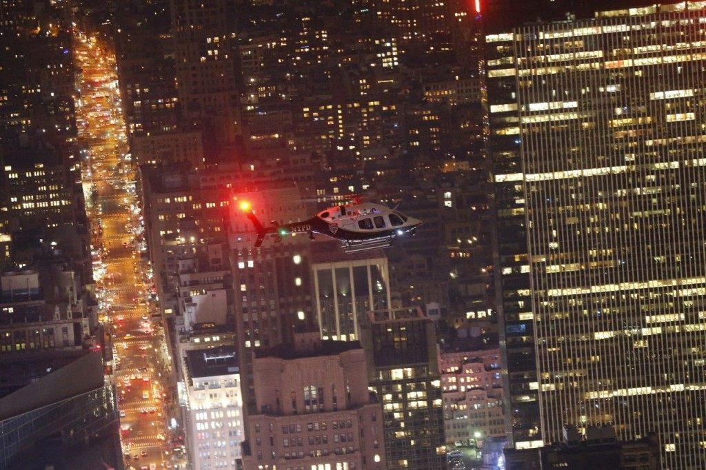 A New York Police helicopter patrols over Times Square during New Year's Eve celebrations, Thursday, Dec. 31, 2015, in New York. (AP Photo/Julio Cortez)