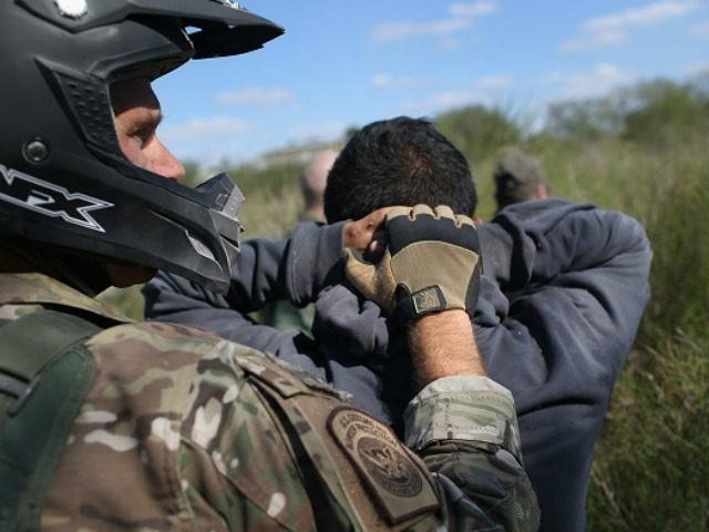 A U.S. Border Patrol agent leads undocumented immigrants through the brush after capturing them near the U.S.-Mexico border on December 7, 2015 near Rio Grande City, Texas. Border Patrol agents continue to detain hundreds of thousands of undocumented immigrants trying to avoid capture after crossing into the United States, even …