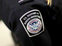 A U.S. Customs and Border Protection officer's patch is seen as they unveil a new mobile app for international travelers arriving at Miami International Airport on March 4, 2015 in Miami, Florida. Miami-Dade Aviation Department and U.S. Customs and Border Protection (CBP) unveiled a new mobile app for expedited passport …