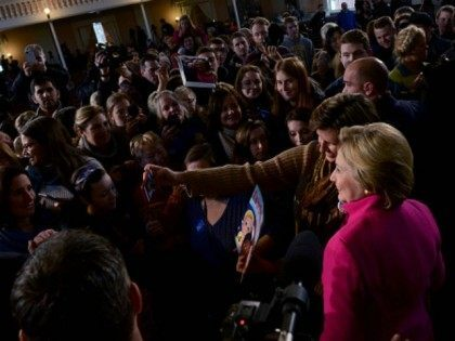 Democratic Presidential candidate Hillary Clinton has her photo taken with a supporter at South Church December 29, 2015 in Portsmouth, New Hampshire. Clinton continues to poll strong in New Hampshire as the year comes to a close. (Photo by