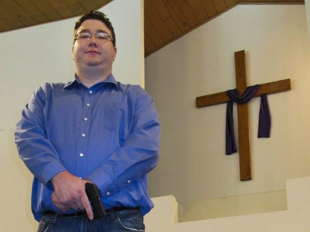 Conceal carry pastor (Jim Suhr : Associated Press)