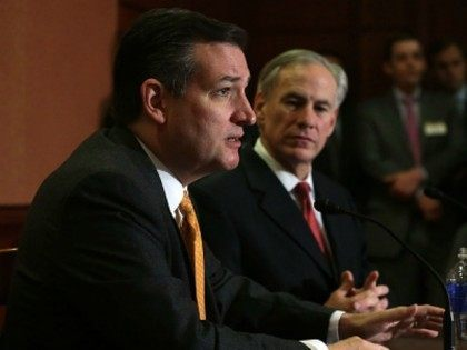 Republican presidential candidate Sen. Ted Cruz (R-TX) (L) and Texas Governor Greg Abbott (R) participate in a news conference December 8, 2015 on Capitol Hill in Washington, DC. Sen. Cruz will introduce legislation addressing the Obama Administration's effort to resettle Syrian refugees in the United States. (Photo by