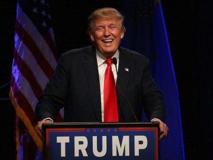 Donald Trump laughs (Justin Sullivan / Getty)