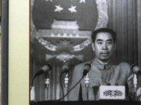 A visitor rests beside a picture featuring late Chinese premier Zhou Enlai delivering a speech during a photo exhibition on the life of Zhou to mark the 110-year-anniversary of his birthday, on March 5, 2008 in Wuhan fo Hubei Province, China. Zhou Enlai, born in Huaian of Jiangsu Province on …