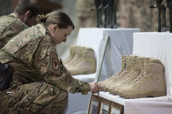 Airmen pay their respects to their fallen comrades.