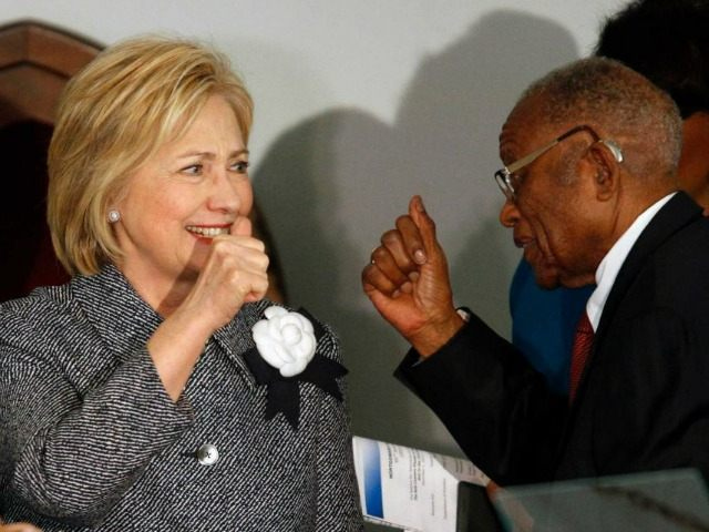 Democratic presidential candidate Hillary Clinton greets and gives a thumbs-up to Fred Gray, Rosa Parks former attorney, before speaking at the Dexter Avenue King Memorial Baptist Church, Tuesday, Dec. 1, 2015, in Montgomery, Ala. Mrs. Clinton's keynote address is part of a two-day event put on by the National Bar …